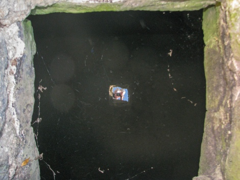 Looking down a well.