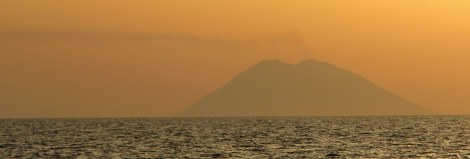 Stromboli, an active volcano, blows off a little steam at sunset.