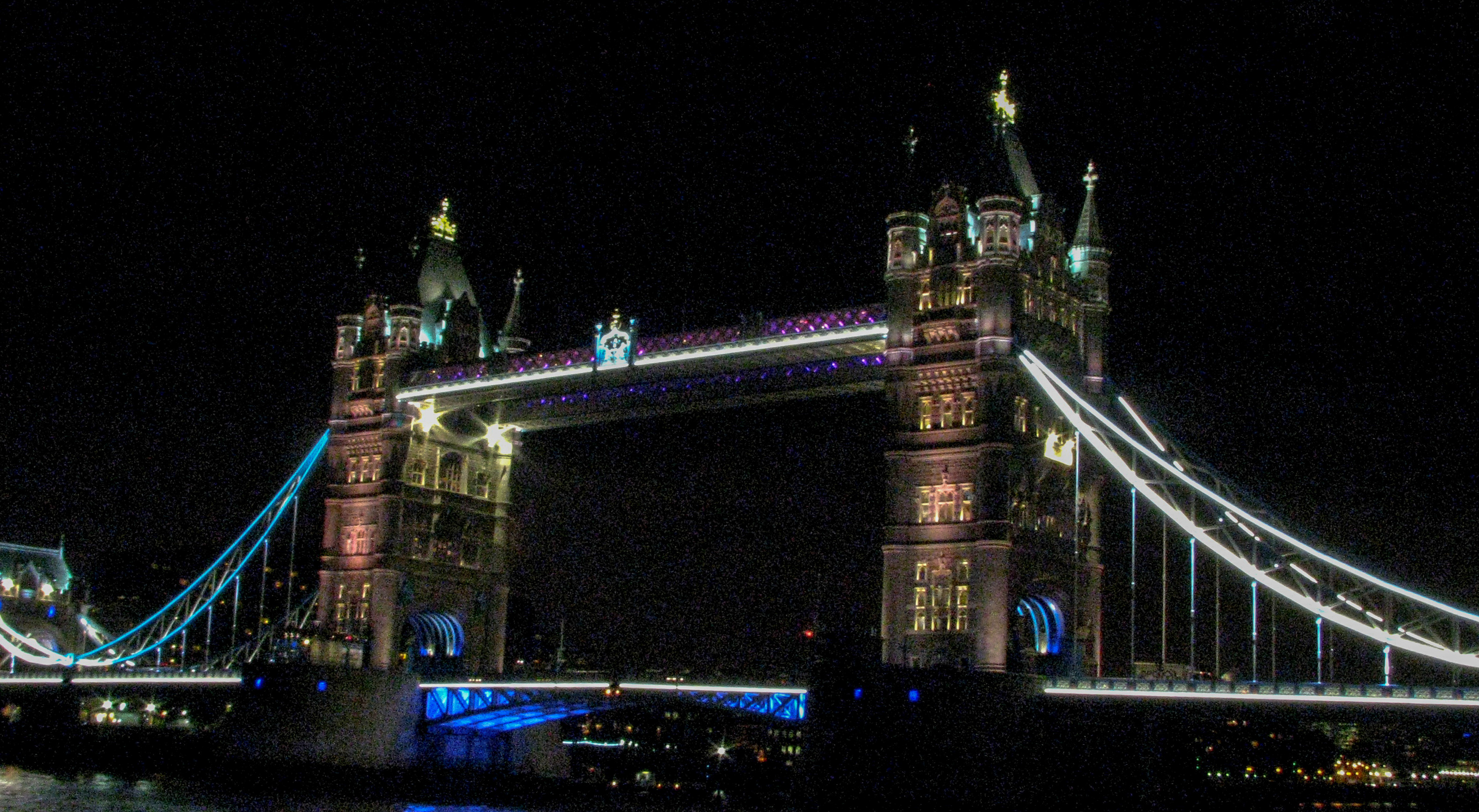 Leander's neighbor at St. Katherine's dock, the Tower Bridge, lit up at night.
