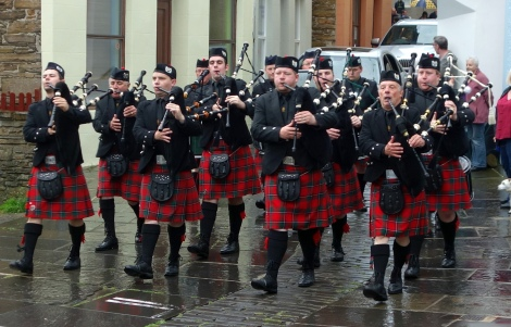 The Kirkwall Pipe Band marches during Shopping Week.