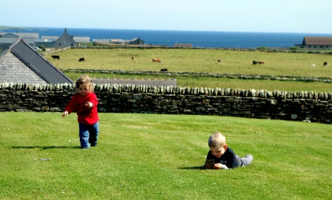 Aylin and Alexander at play in Pierowall, Westray, Orkney.