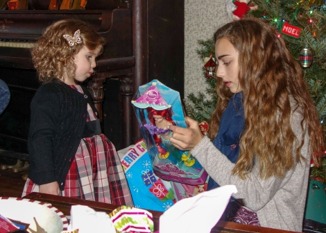 Aylin and Scarlett opening presents on Christmas Day.