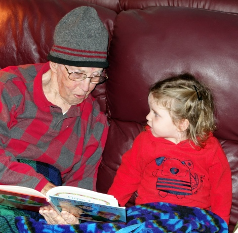 Gramps reads to Aylin.